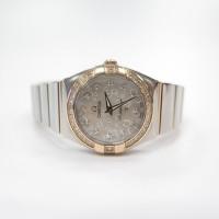 重庆二手的欧米茄碟飞黑盘手表回收店地址